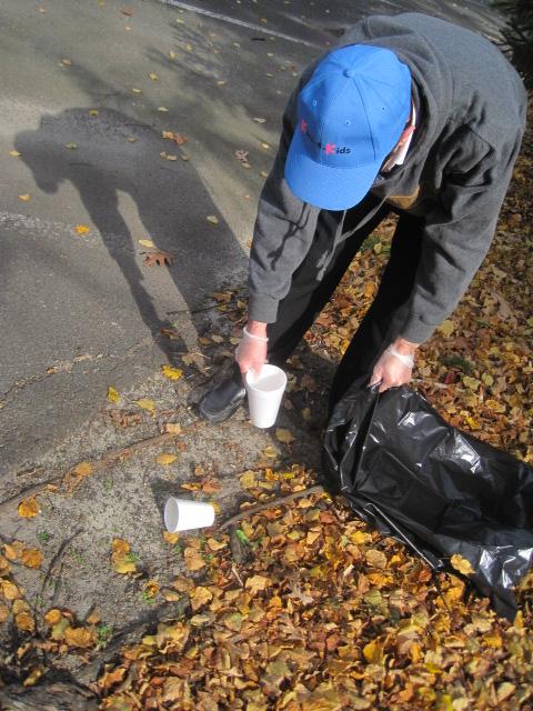 Kars4Kids volunteer picking up garbage