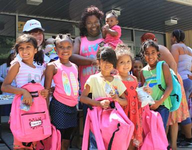 children holding backpacks