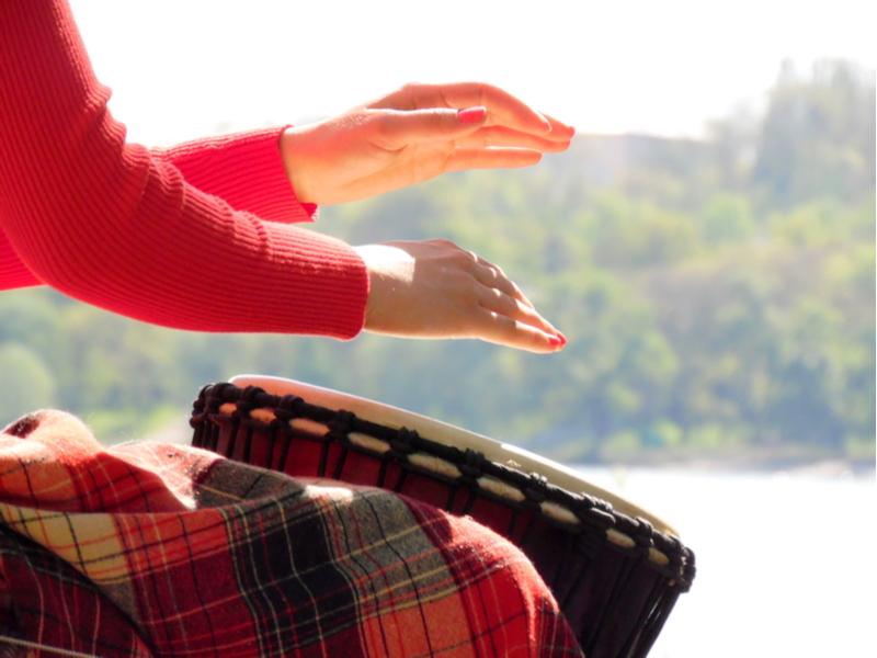 Woman plays the darbuka