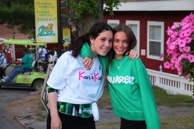Mentor hugs young teenage girl