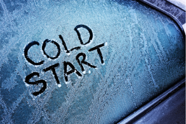 """Frosted over car window with writing """"Cold Start"""""""