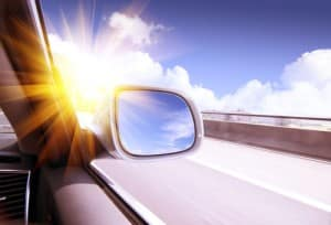 Sun glare on car side mirror