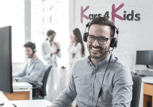 Smiling Kars4Kids Customer Service Rep
