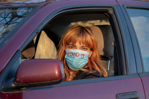 Driver wearing face mask