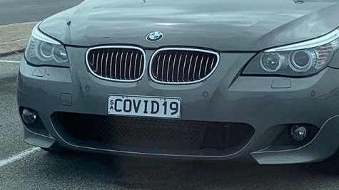 Screenshot of gray BMW with COVID19 license plate
