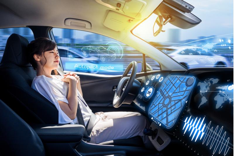 hands free woman rider in autonomous car