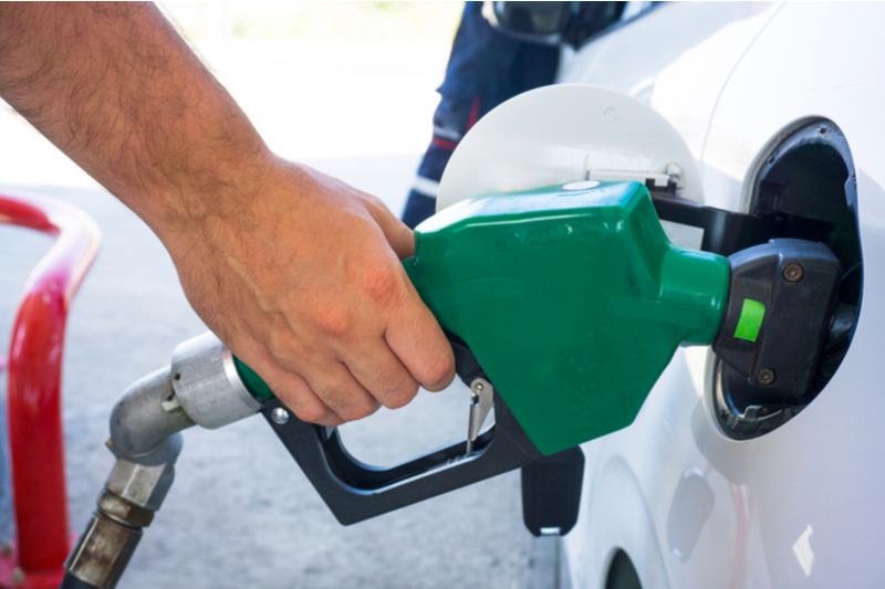 Gas pump inserted into gas tank fuel door