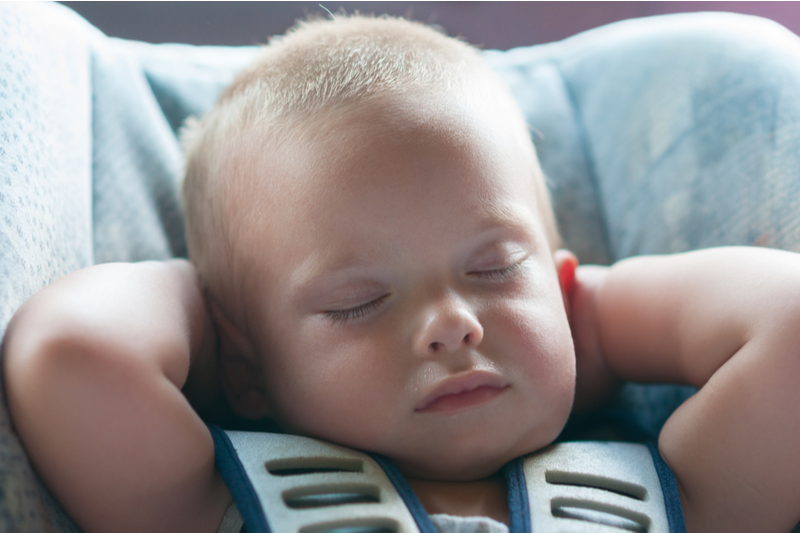 unattended child in vehicle: infant boy sleeps peacefully secured seat