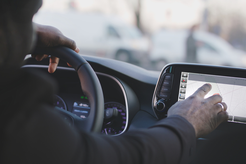 close up of black man hand typing on EV screen