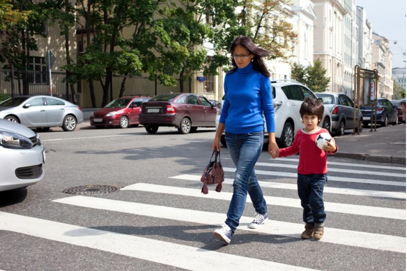 woman and child cross at pedestrian crosswalk