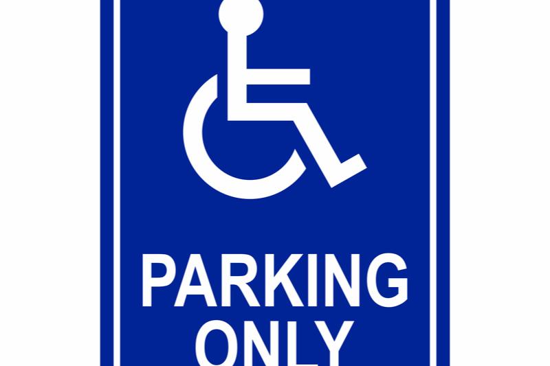 handicap parking spot sign with wheelchair