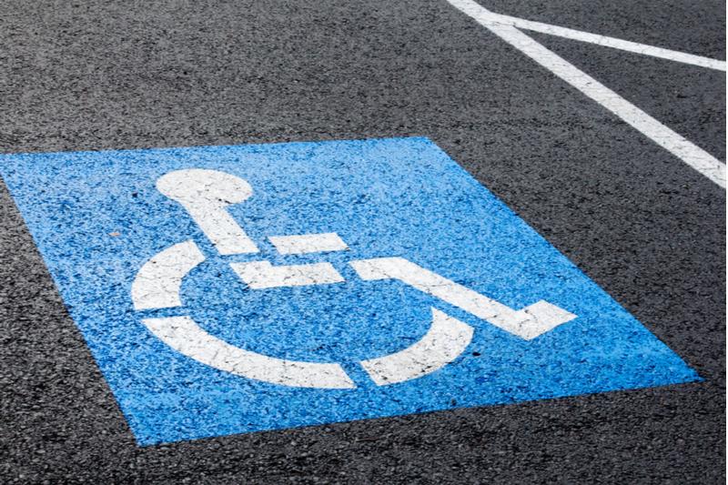 handicap parking spot with blue wheelchair symbol