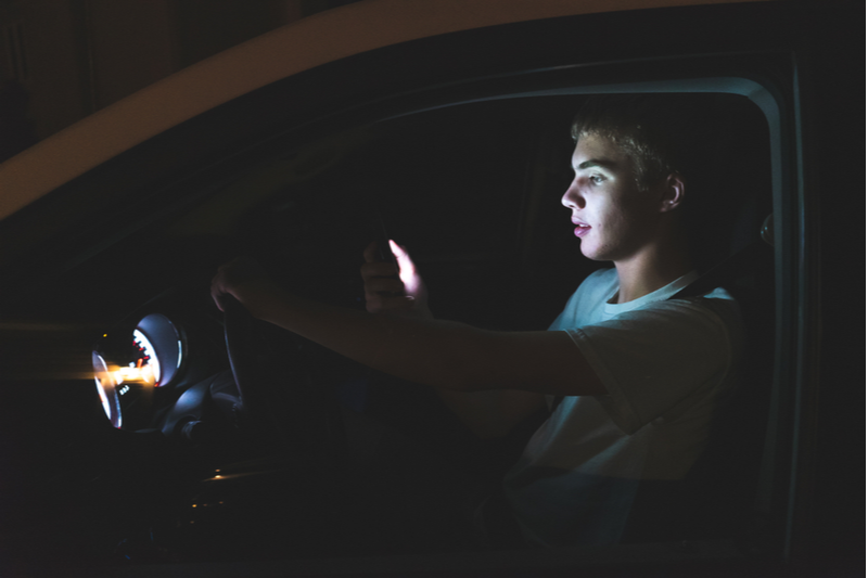 Night driving teen distracted by phone